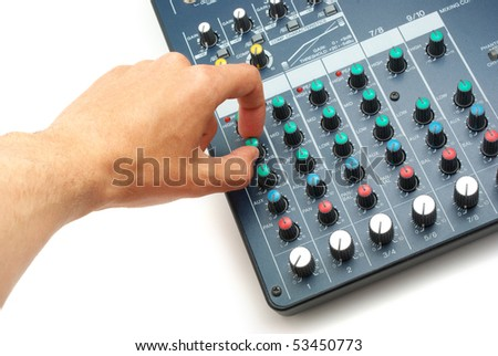 Hand and sound mixing console. Element of design. - stock photo