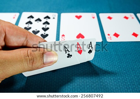 Hand and three aces , playing cards - stock photo