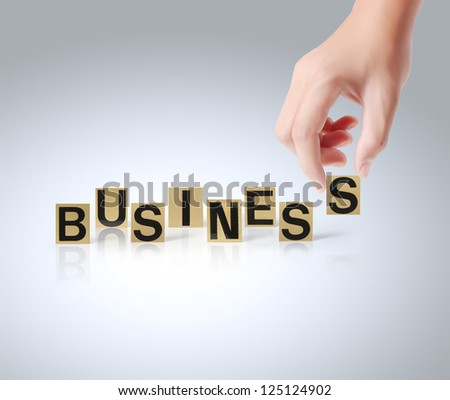 Hand and word Business on white background - stock photo