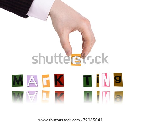 Hand and word marketing isolated on white background - stock photo
