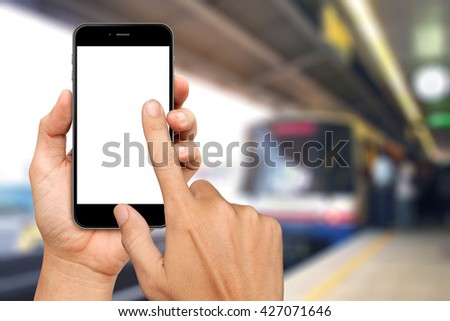 Hand are holding and touch Smartphone with sky train background - stock photo