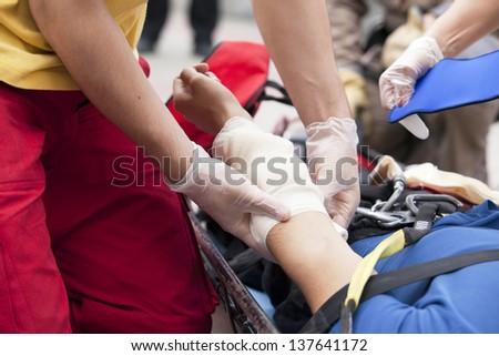 Hand bandaging - stock photo