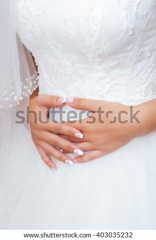 hand beautiful girl bride in white wedding dress  - stock photo