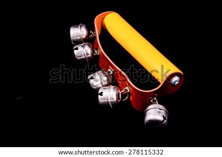 Hand bells musical instrument for ringing on a black background - stock photo