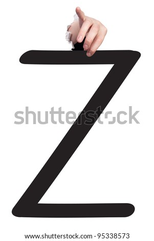 Hand breaking white paper surface holding letter 'Z' from alphabet set