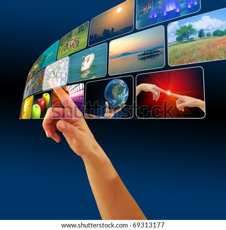 Hand browsing images in virtual space using touch screen interface, concept for e-commerce or cyberspace - stock photo