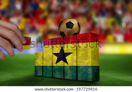 Hand building wall of ghana flag in grunge effect - stock photo