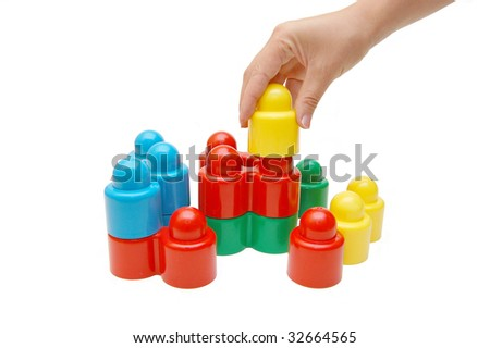 hand builds construction from cubes - stock photo