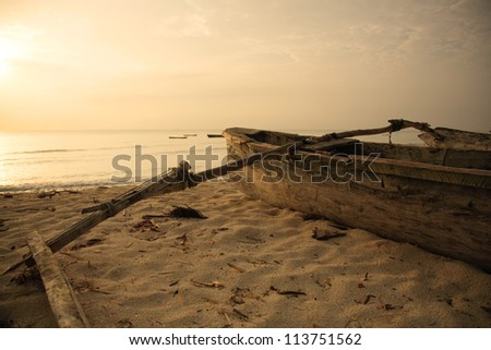 Hand built catamaran on the beach at sunrise Mombasa Kenya - stock photo