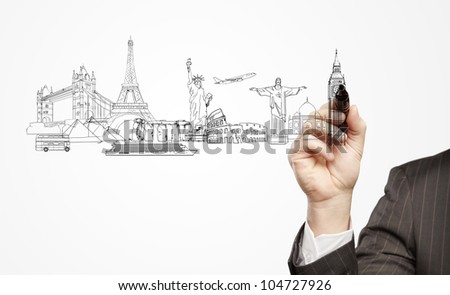 hand businessman draws a architectural buildings
