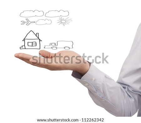 hand businessman hold a model house and car - symbol of wealth being modern life journeys crossing