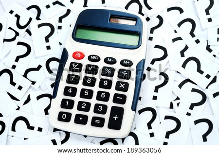 Hand calculator on question mark background - stock photo