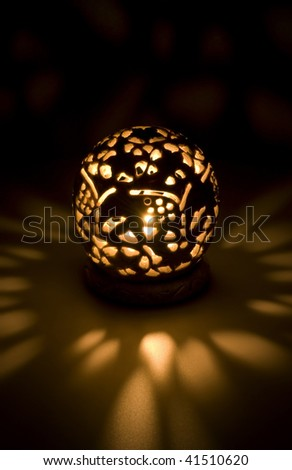 Hand carved Indian Lantern lit with candle