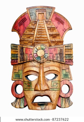 Hand carved wooden Mayan mask isolated on a white background - stock photo