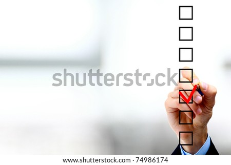 Hand choosing one of three options - stock photo