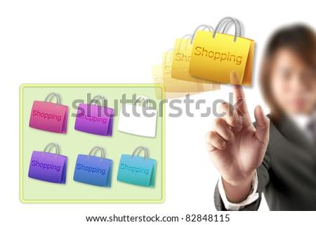 hand choosing shopping cart - stock photo