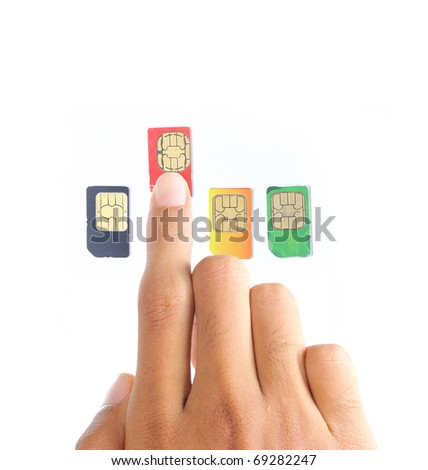 hand choosing the best sim card or cellular provider - stock photo
