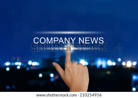 hand clicking company news button on a touch screen interface  - stock photo