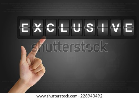 hand clicking exclusive on Flip Board Display - stock photo