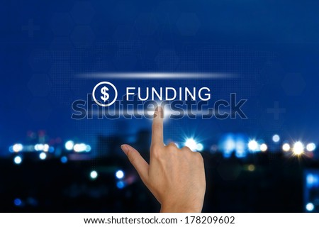 hand clicking funding button on a touch screen interface  - stock photo