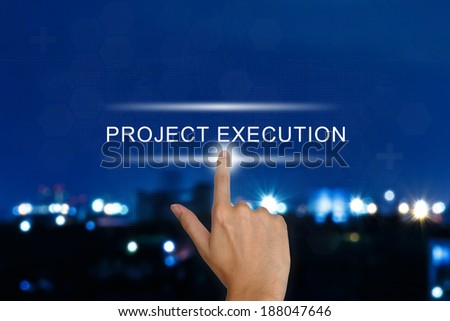 hand clicking project execution button on a touch screen interface  - stock photo