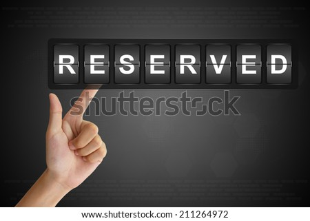 hand clicking reserved on Flip Board Display - stock photo