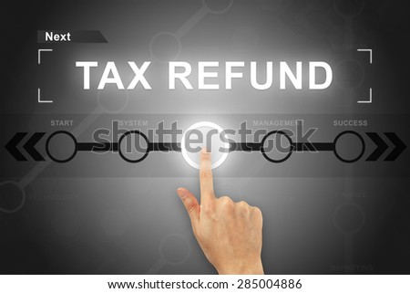 hand clicking tax refund button on a touch screen - stock photo
