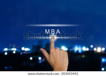 hand clicking The Master of Business Administration (MBA or M.B.A.) button on a touch screen interface  - stock photo