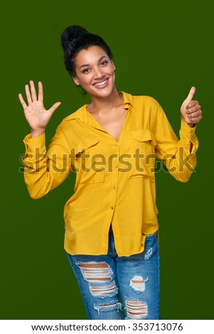 Hand counting - six fingers. Happy mixed race african american - caucasian woman indicating the number six with her fingers - stock photo