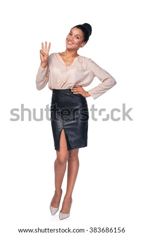 Hand counting - three fingers. Happy mixed race african american - caucasian woman showing three fingers standng in full length over white background - stock photo