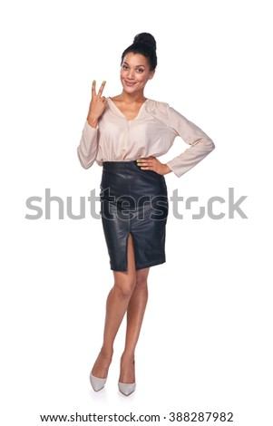 Hand counting - two fingers. Full length smiling mixed race african american - caucasian woman showing two fingers, V sign - stock photo