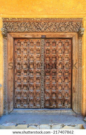 Hand crafted wooden door post at Stone Town, Zanzibar - stock photo