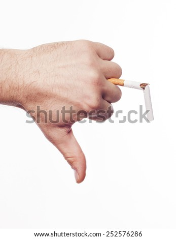 Hand crushing cigarette over white background