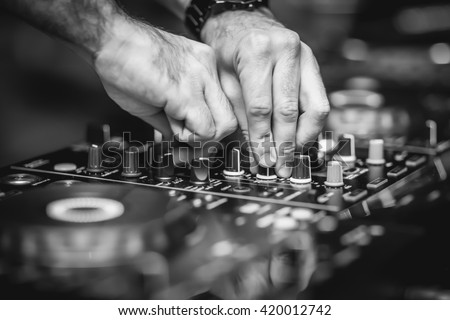 Hand detail of a DJ on the mixer - stock photo