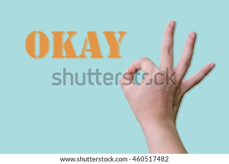 hand doing okay sign on colorful background flat design