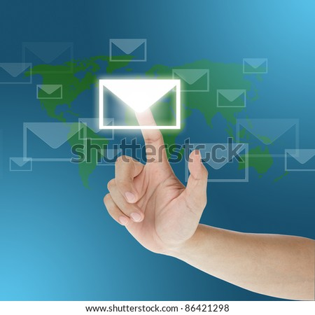 hand dragging mail on touch screen - stock photo