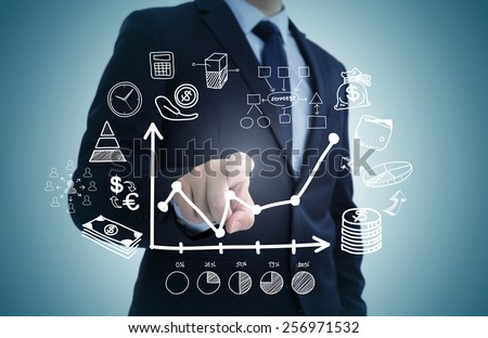 Hand draw business sketches doodle infographic elements,chart graph,concept businessman hand touch analytics earnings - stock photo