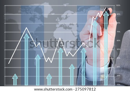 hand drawing a growing graph - stock photo