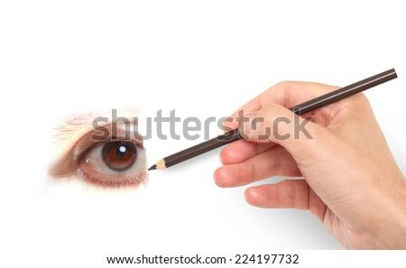 Hand drawing a human eye - stock photo