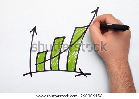 Hand drawing business graph on white paper - stock photo