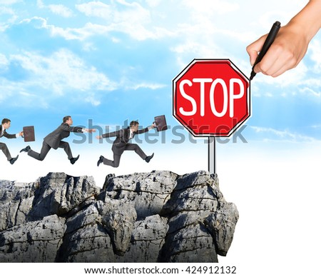 Hand drawing businessman running to sign stop on rock and blue sky - stock photo