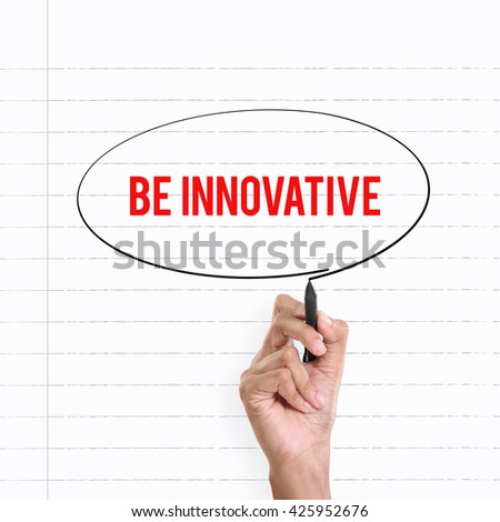 "Hand drawing circle around the note ""BE INNOVATIVE"", lined book page on the background - stock photo"