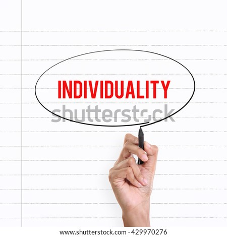 """Hand drawing circle around the note """"INDIVIDUALITY"""", lined book page on the background - stock photo"""