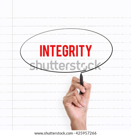 """Hand drawing circle around the note """"INTEGRITY"""", lined book page on the background - stock photo"""