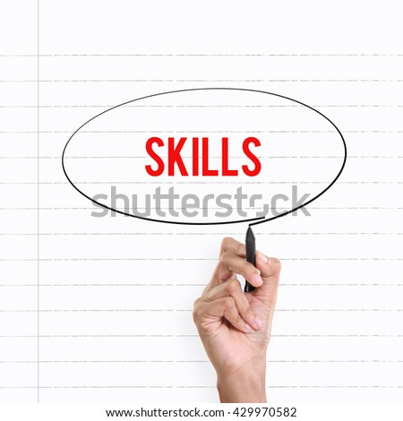 """Hand drawing circle around the note """"SKILLS"""", lined book page on the background - stock photo"""
