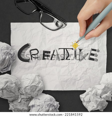 hand drawing design word CREATIVE on crumpled paper with as concept - stock photo