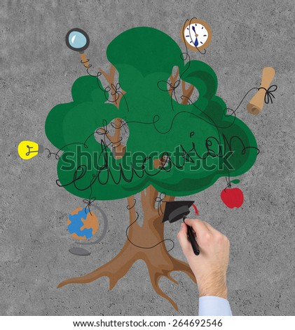 hand drawing education tree with icons on wall - stock photo