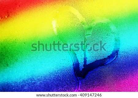 Hand drawing heart on the wet window glass, Gay 8 stripe flag gradient, gay love concept - stock photo