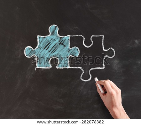Hand Drawing Inter Connected Different Colored Puzzle Pieces with Chalk on Black Board, Concept Image Illustration Connection and Teamwork - stock photo