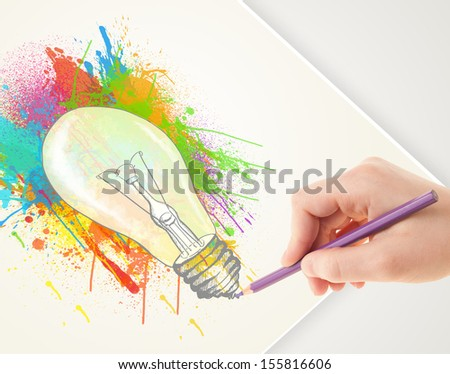Hand drawing on a plain paper a colorful splatter lightbulb - stock photo
